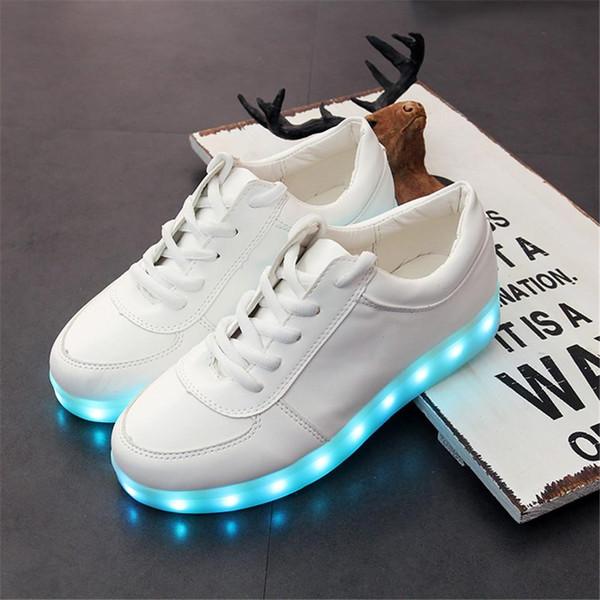 Chaussures d'enfants de magasins d'usine avec la roue, chaussures de bébé de garçons et filles LED légers, enfants allument le baskate de skate