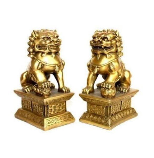 Una coppia di statue cinesi in ottone tibet foo dogs Lions