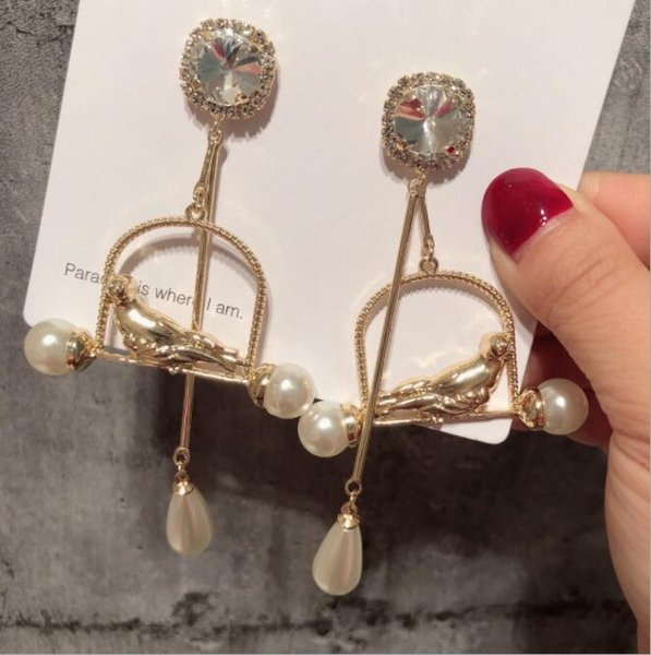 Fashion exaggerated drop pearl bird cage earrings female exaggerated retro personality crystal earrings Quick delivery