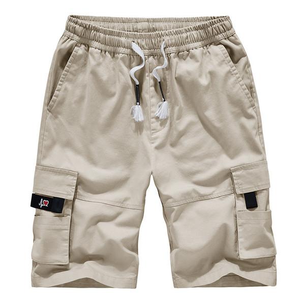 Combinaison de marque Hommes Combinaison Marque Tide Hommes Lâche Pantalon à poches multiples Casual Cinq Pantalons Shorts Hommes Pantalon de plage d'été