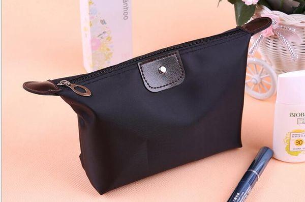 top popular Factory Direct Candy-colored Dumpling Cosmetic Bag Dumpling Bag Folding Waterproof Cosmetic Wash 2020 2021