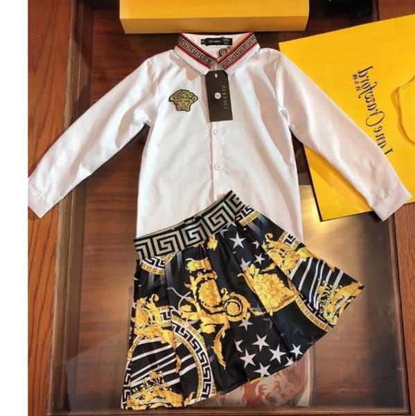 Mädchenrock stellt Kinderdesignerkleidung weißes Revershemd + gedrucktes schwarzes Rock 2pcs Fallmädchensätze Größe 100-140cm ein