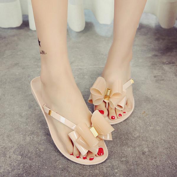 Sapatas das mulheres novas sandálias das mulheres da moda sapatos de geléia plana arco flip flops praia verão rebites chinelos sandálias tanga nu