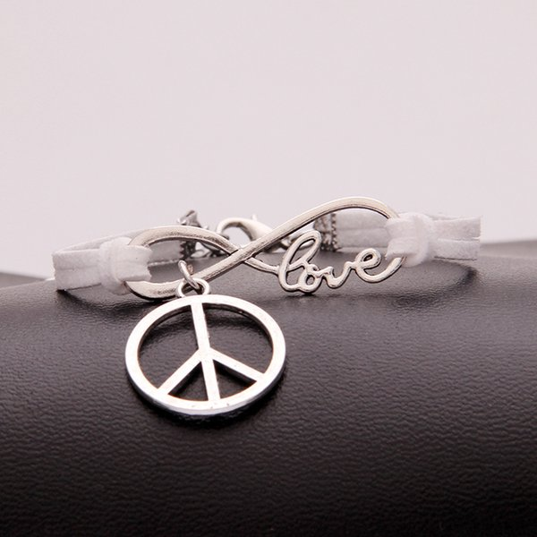 Vintage Charming Silver Infinity Love Peace Sign bracelets Weave white leather suede cuff jewelry for women men 2018 Boho Bangles Wholesale
