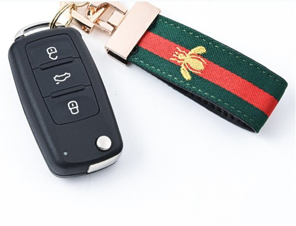 Diseñador de moda hebilla de la llave famoso de lujo llavero de lujo hecho a mano marca coche llavero de cuero bolsa de tela accesorios con estilo de alta calidad