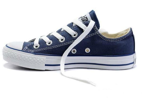Venda quente top Clássico design homens mulheres baixos sapatos de lona sapatos de skate