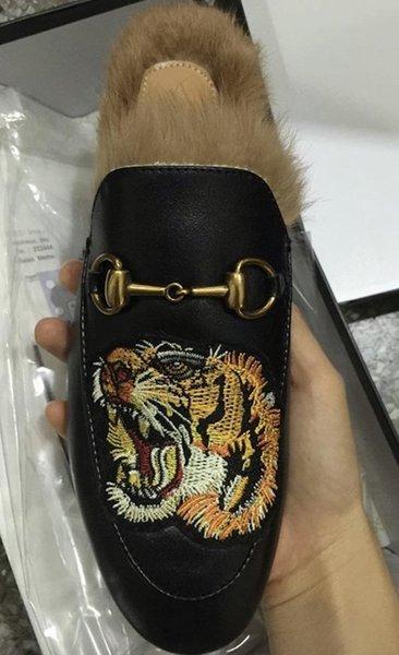 Black leather / tiger