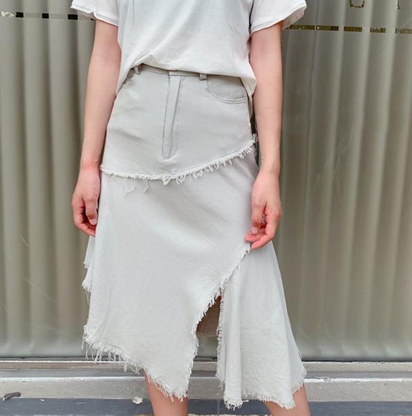 Senhoras da moda saia verão novo design de cor sólida de algodão irregular e linho Uma palavra saia dividida saia senhoras roupas atacado