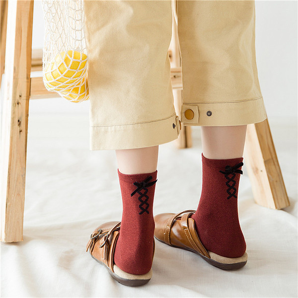 2018 HOT winter tide socks autumn and winter cotton women hosiery japanese ladies bow cross cute solid color socks
