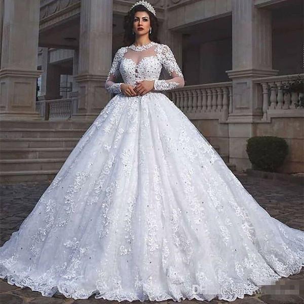 2019 Principessa Sheer Girocollo Abiti da sposa Maniche lunghe Pizzo Appliques Perline Puffy Musulmano Dubai Arabo Abiti da sposa Abito da sposa Personalizzato