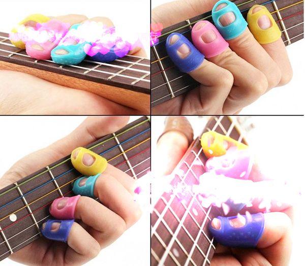 4 pezzi / set chitarra string protezione dito punta delle dita protezione della mano sinistra in silicone protezione dito accessori per chitarra, dimensioni opzionali.