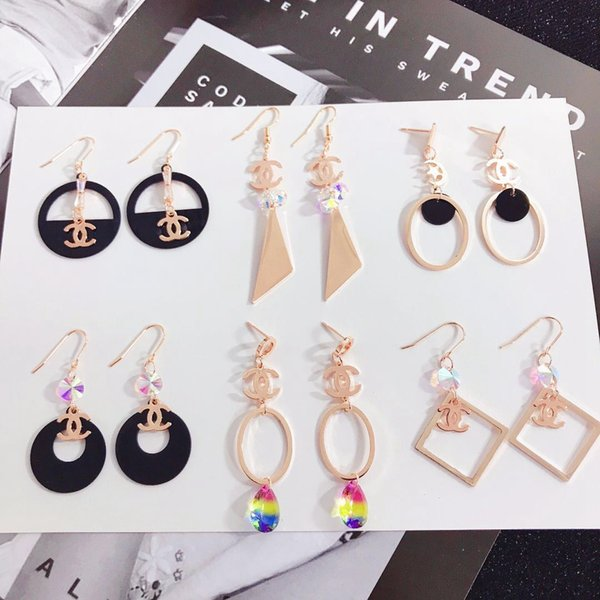 Gli orecchini di amore di fascino di marca di lusso dell'orecchino del perno di acciaio di titanio del marchio famoso di marca incantano i monili all'ingrosso dei monili di modo