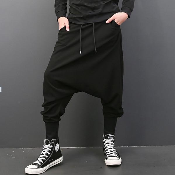 Nuevo estilista del hip hop moda pantalones harem bajos marea masculina versión coreana del cantante suelto haz de pie harem pantalones trajes
