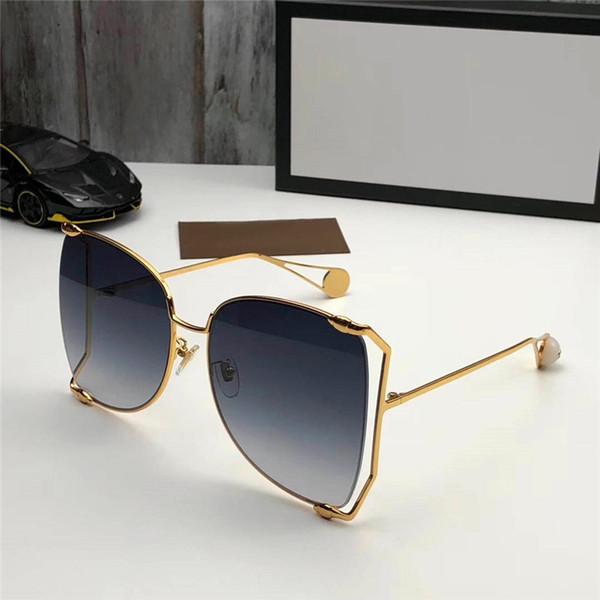 Nuevo diseñador de moda perlas gafas de sol 0252 gran marco redondo de metal marco hueco de calidad superior color claro gafas de sol decorativas estilo popular