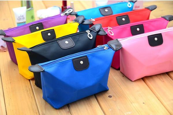 Koreanische Version von niedlichen Knödel Linie Make-up-Tasche, Süßigkeiten Farbe Klappknödel, Yuanbao-förmige Imprägnierung, waschen und Spülen Tasche