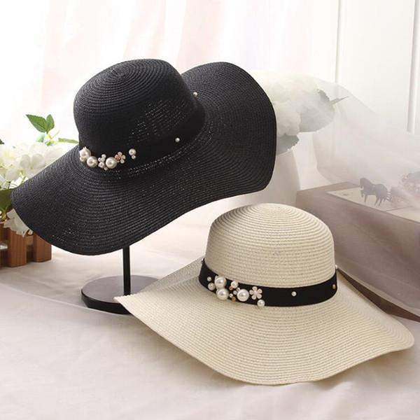 oZyc New Spring Summer Hats For Women Flower Beads Wide Brimmed Jazz Panama Hat Chapeu Feminino Sun Visor Beach Hat Cappello D19011103