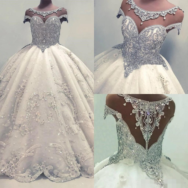 Luxury Beade Crystal Ball Gown Wedding Dresses Sheer Neck Illusion Back Lace Applique Handmade Flowers Chapel Cap Sleeves Wedding Gown