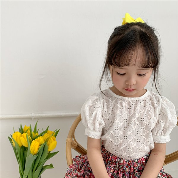 top popular 2020 Summer Korean Girls Hollow Out Shirt Girl Cotton Round Neck Puff Sleeve Shirts Tops Kids Toddler Baby Short Sleeve Blouse Y200704 2021