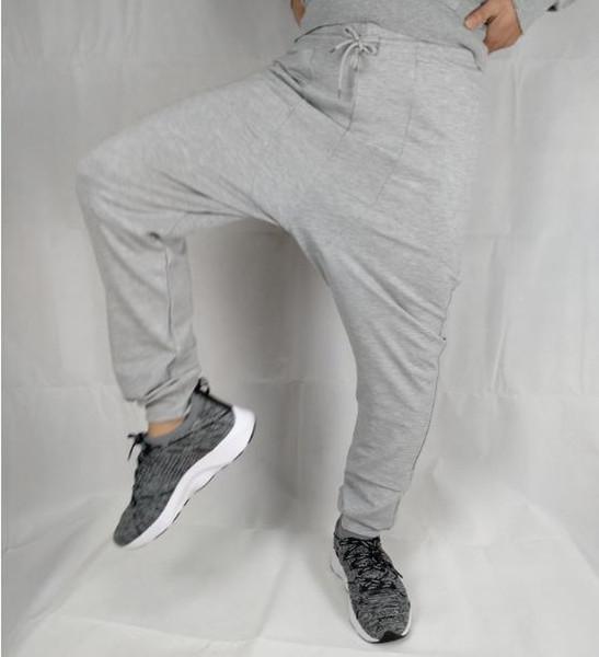 Pantaloni larghi Hip Hop Pantaloni sportivi Harem Pantaloni casual Uomo Ragazzi Ragazza Pantaloni sportivi Nero Grigio Tasche larghe Pantaloni Abbigliamento sportivo di cotone Abbigliamento pista XXL