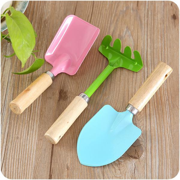 top popular Home Gardening Tools Mini Wooden Handle Small Shovel Rake Three-Piece Set Flower Pot Small Flower Shovel 2021