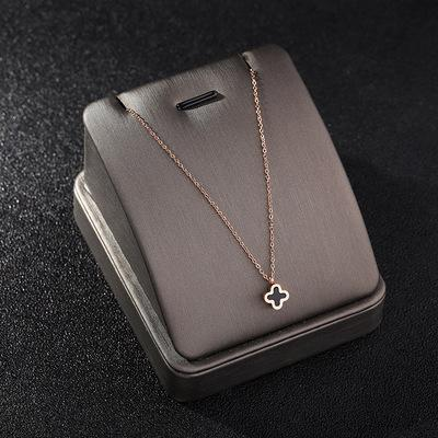Four-leaf clover necklace ECG hollow skeleton clavicle chain letter H pendant black round cake pendant necklace fashion jewelry