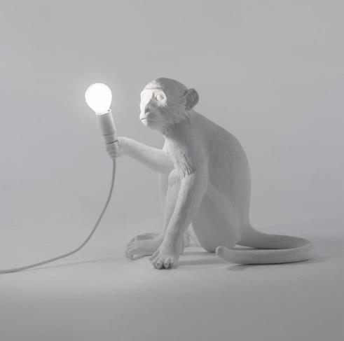 scimmia lampada da tavolo bianco