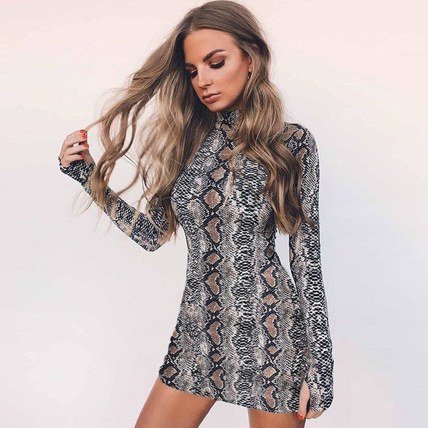 New style fashionable sexy female dress, snakeskin wrap buttock tight dress, long sleeve round collar shows figure female dress