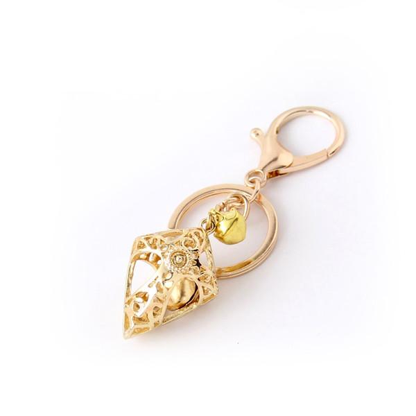 Ouro Oco cruz chaveiros Com Sino De Metal Bonito Acessórios de Moda Cadeia Saco Chave Pingente de Presente Pequeno Por Atacado Presentes de Páscoa