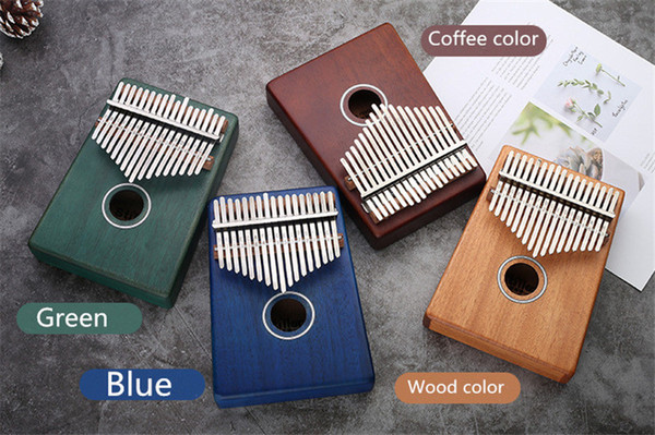 top popular Three colors 17 metal Keys Kalimba Wood Mahogany Body Thumb Piano play with guitar Musical Instrument accessories 2021