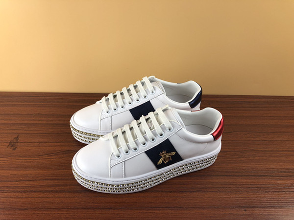 Top designer Europe station casual lacing small white shoes breathable perforated leather printed bee female height shoes