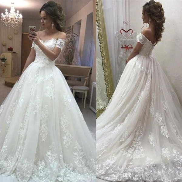 2018 Elegant Ivory A Line Wedding Dresses Off The Shoulder Full Lace Appliques Beaded Sweep Train Puffy Plus Size Bridal Gowns Arabic Dubai