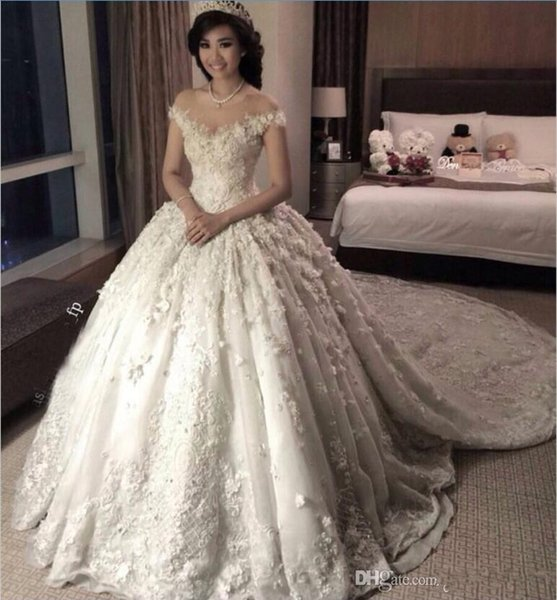 2019 New Luxury Arabic Ball Gown Wedding Dresses Cap Sleeves Lace Appliques 3D Floral Flowers Puffy Chapel Train Plus Size Bridal Gowns
