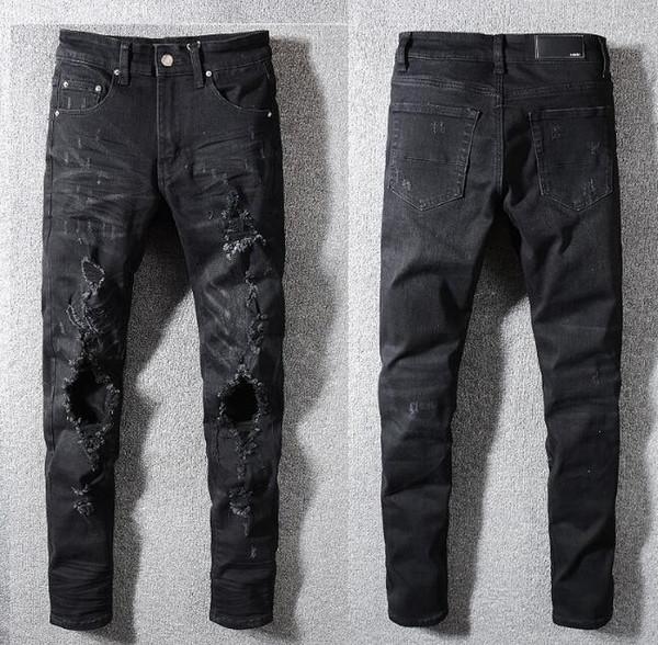 Pantalones vaqueros negros Moda para hombre Pantalones vaqueros de la motocicleta Biker Jeans Rock Revival Flaco Delgado agujero rasgado Mens Denim Pantalones de diseño