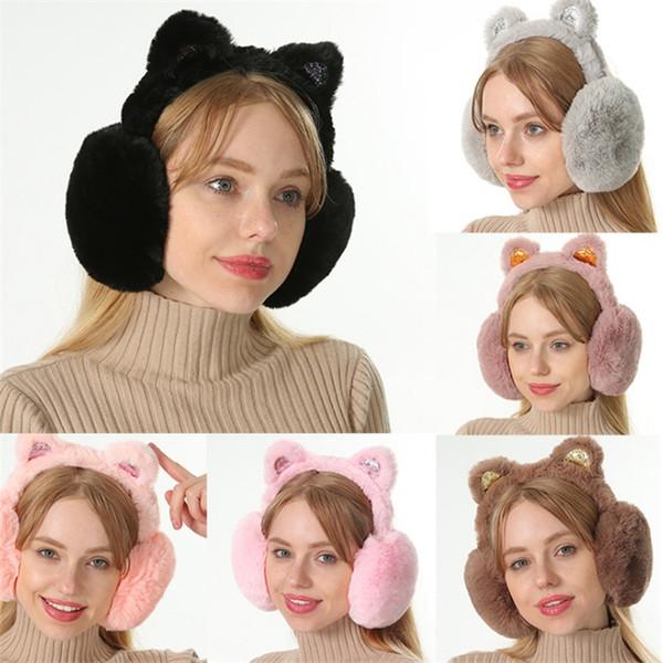 Versión coreana de las orejeras de invierno nuevas damas calientes orejeras de arco lentejuelas orejas de gato orejeras de felpa T7C5001