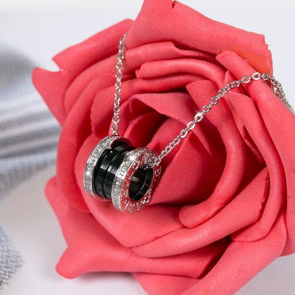 Silver + gems + black ceramic