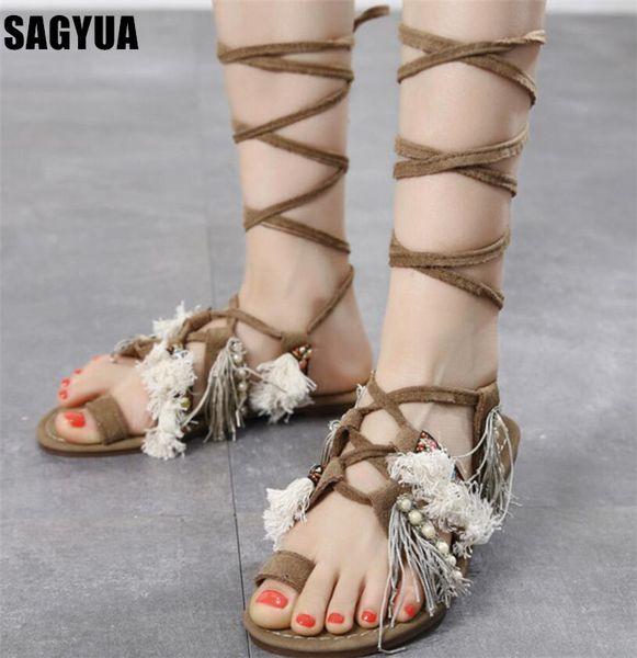 Kadın ayakkabı yeni halk özel inci daireler bayanlar püskül Çapraz kayış Rahat ayakkabılar yaz Burnu açık dantel up Plaj kadın sandalet A1004