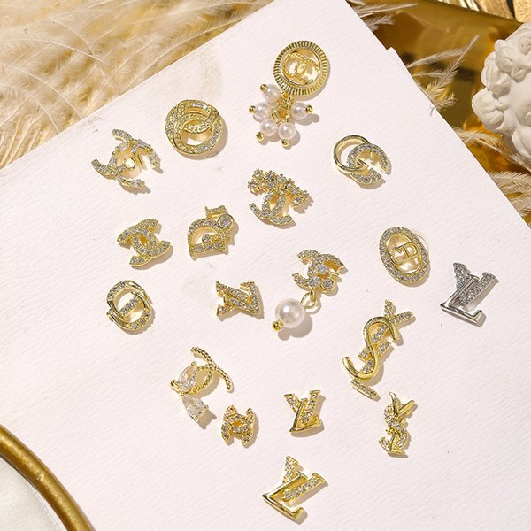 top popular Nail Art Decorations Metal With Diamond Drill Jewelry Luxurious Luxury 2020 New Design Brand Logo Gold Color Nail Salon Store 2021