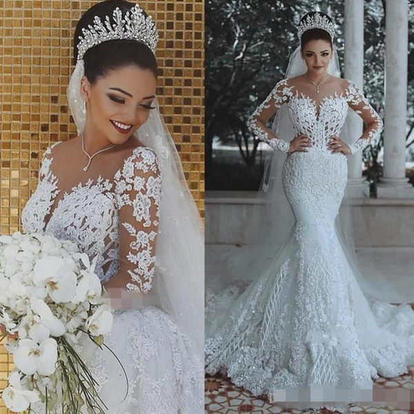 Luxury Appliqued Beaded Crystal Mermaid Wedding Dresses Long Sleeves Sheer Neck Sweep Train Chapel Wedding Gown vestido de novia