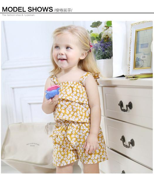 2019 Summer new kids beach holiday outfits girls polka dots falbala suspender princess tops+flowers printed dovetail skirt 2pcs sets