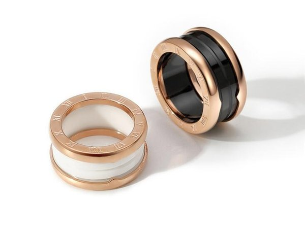 Europa y los Estados Unidos cerámica en blanco y negro arco anillo de acero de titanio moda marea salvaje anillo de primavera