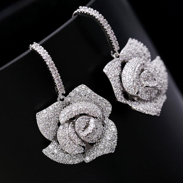 European exaggerated dinner three-dimensional camellia earrings micro-inlaid zircon luxury ear hook earrings online star with the earrings