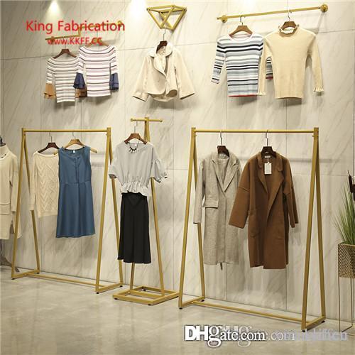 Présentoir de magasin de vêtements doré mur supérieur, support de vêtements pour enfants, porte-vêtements latéraux suspendus.