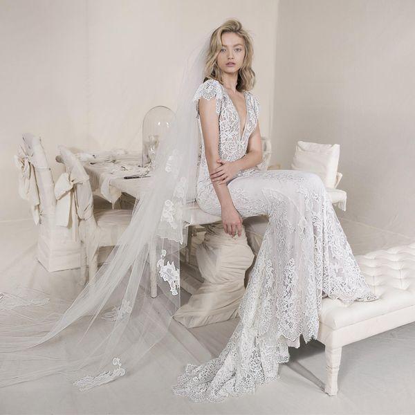 Lihi Hod Mermaid Lace Wedding Dresses Deep V Neck Cap Sleeve Backless Country Wedding Gowns Custom Made Boho Beach Bridal Dress