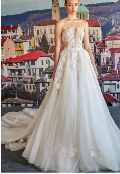 This voluminous 3D ballgown features a sheer corset top and scoop neckline, with a full skirt made of embroidered tulle and further adorned1