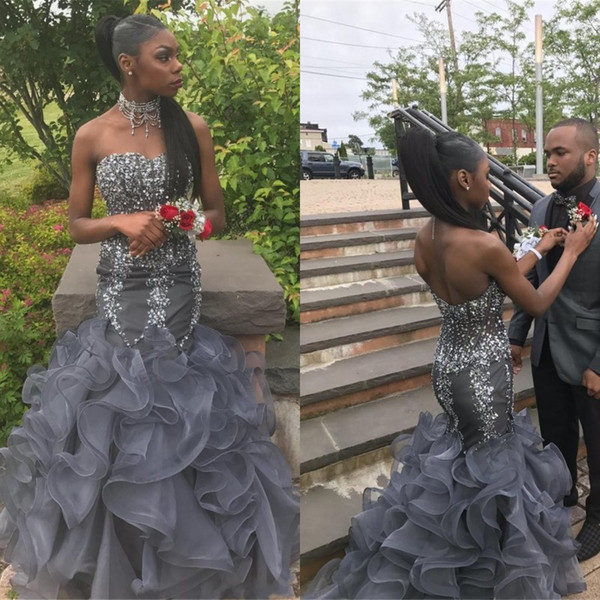 2020 Vestidos de fiesta de sirena de cristal africanos magníficos Peplum Sweetheart Beading Appliques Vestidos de noche formales baratos con volantes en cascada