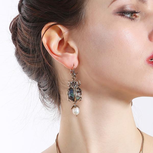 Oumeifeng boucles d'oreilles coccinelle personnalité féminine mode perle naturelle pendentif coiffures en gros