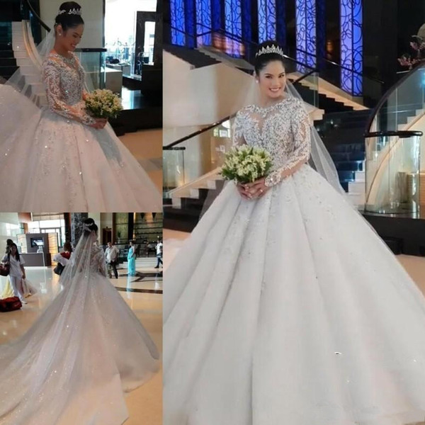 Luxurious Muslim Ball Gown Wedding Dresses Jewel Neck Lace Appliques Beads Sequins Long Sleeves Cathedral Train Arabic Formal Bridal Gowns