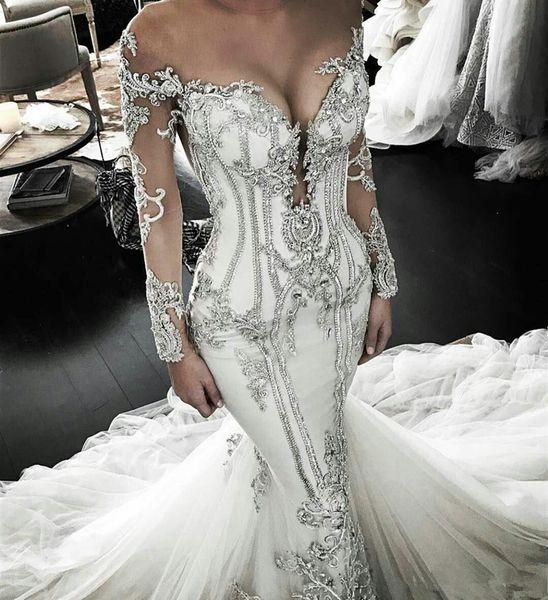 Luxury Mermaid Wedding Dresses Sparkly Crystal Beaded Plus Size Long Sleeves Bridal Dress Sweep Train Sheer Jewel Neck Vestido De Novia