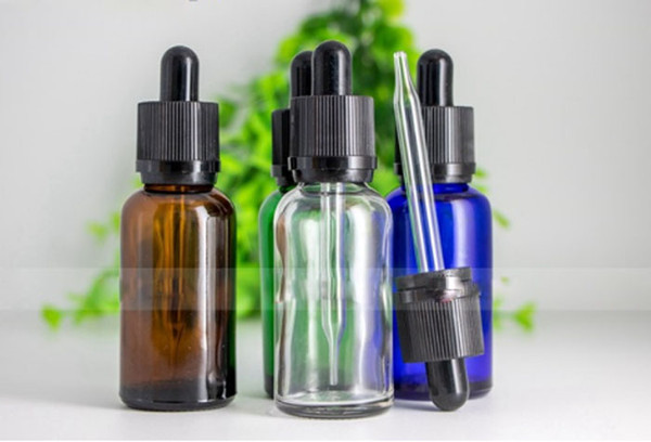 Childproof Evident Tamper Cap 30ml Glass Dropper Bottles Amber Clear Blue Green Bottles 1OZ E Liquid Containers 440pcs Free DHL