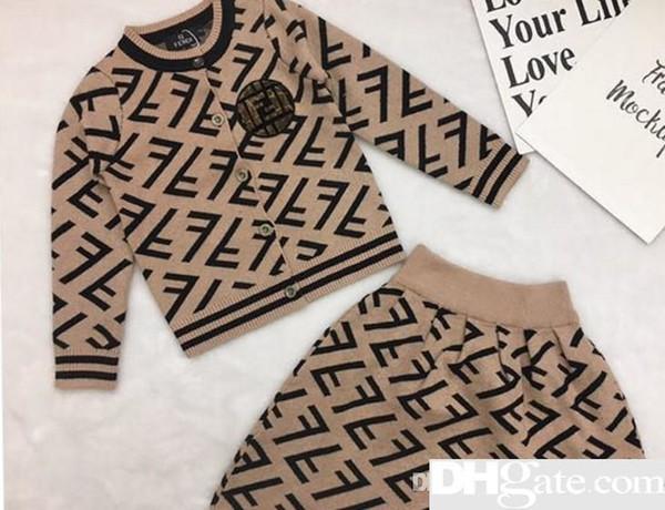 ropa de diseñador para niños Niños nuevos Suéteres de cuello redondo Conjunto de dos piezas Niñas otoño Invierno Jersey con estampado de letras Conjunto de falda plisada